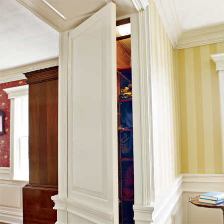 closets hidden in the wide partitions of the master suite in this remodeled greek revival