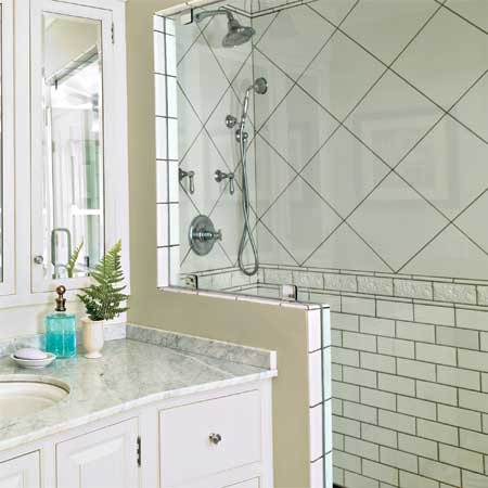 subway tile and a modern shower in the master bath of this remodeled greek revival