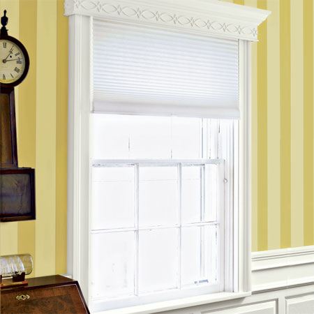 stock windsor casing and built up cornices grace the windows in the master suite of this remodeled greek revival