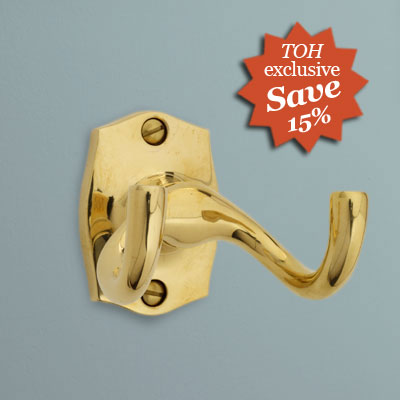 a two-pronged brass robe hook from Urban Archaeology