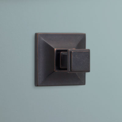 a square-shaped brass hook from Restoration Hardware with an oil-rubbed bronze finish