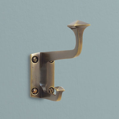 a brass robe hook in a Mission style from Rejuvenation with a burnished antique finish