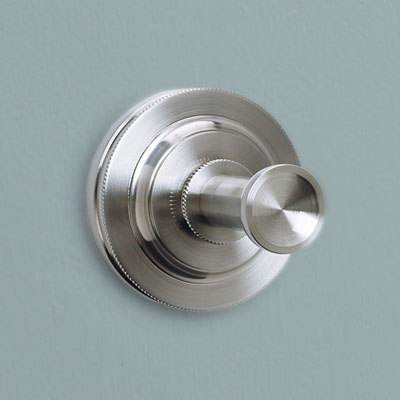 a round Deco style brass hook from Restoration Hardware with a satin nickel finish