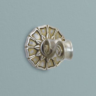 a pewter bath hook from Copper Mountain Hardware with a bronze wash