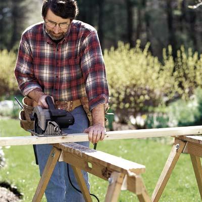 man using circular saw