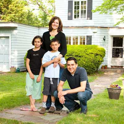 homeowner family before the exterior of the T O H auburndale house before remodel