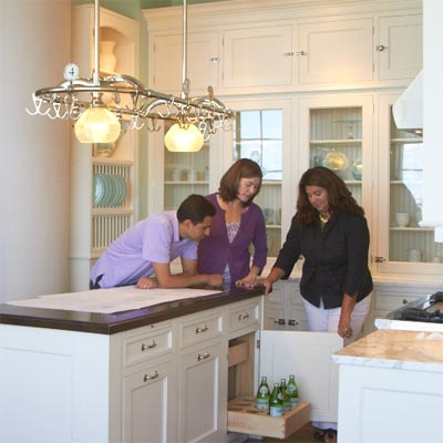 designer discussing plans for the auburndale kitchen remodel with homeowners