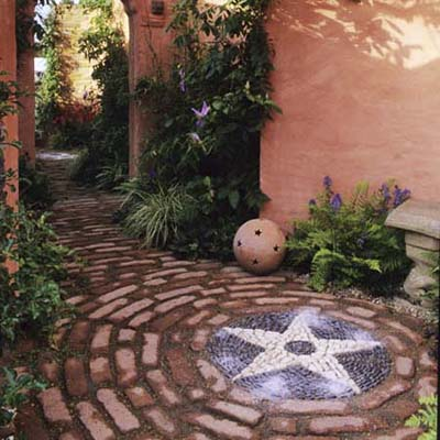 white star offset by dark cobbles and brick rings create this mosaic design