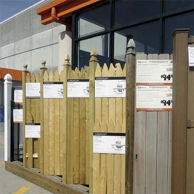 examples of off the shelf fence panels lined up outside a home hardware yard and  garden store