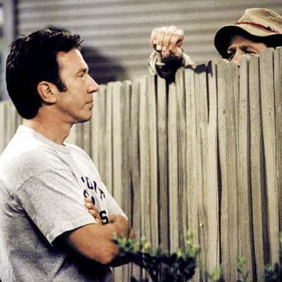 still from tv show of two men talking through a fence