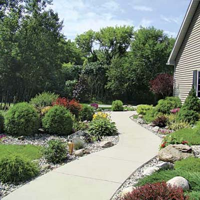 view of walkway and plants in reader's finished pond garden