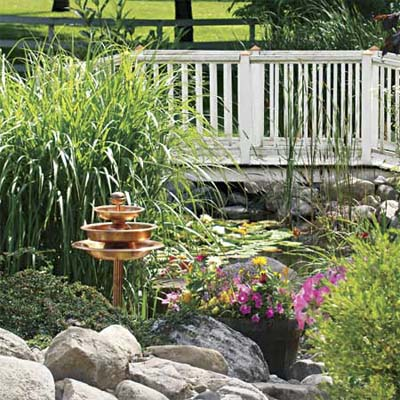 view of bridge in reader's finished pond garden