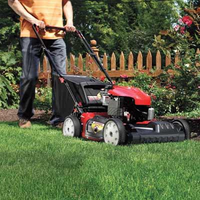 man pushing a lawn mower