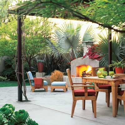 outdoor living space with fireplace, patio dining set and lounge chair