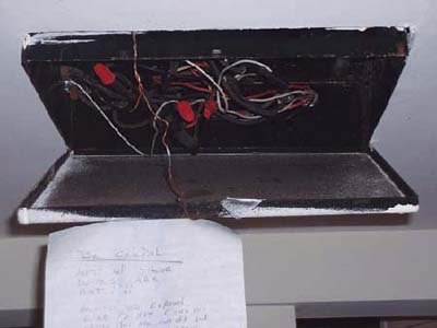 home inspection photo of hot wires in open junction box