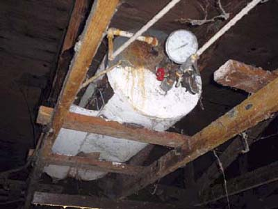 home inspection photo of water heater on its side with pressure gauge