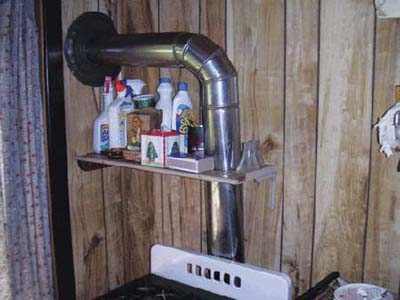 home inspection photo of shelf built around flue