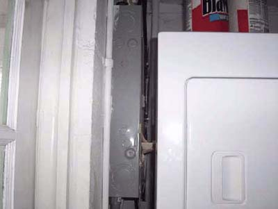 home inspection photo of washer/dryer blocking electrical panel