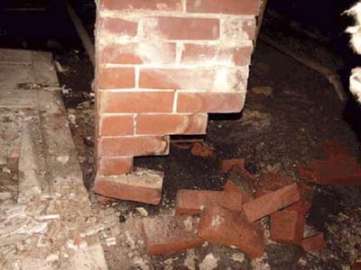 home inspection photo of chimney missing bricks