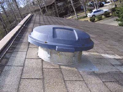 home inspection photo of Rubbermaid garbage can lid used as vent cover