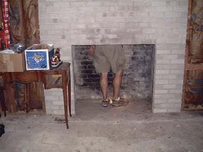 home inspector inside a fireplace