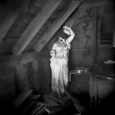 garden statue stored in manor attic ruin