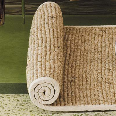 woven bath mat combines cotton and vetiver root