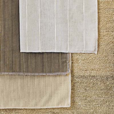 ErtheWeave fabrics, handwoven from natural fibers including linen, silk, and bamboo, then tailored into Roman shades, panel screens, curtains, cornices, and valances
