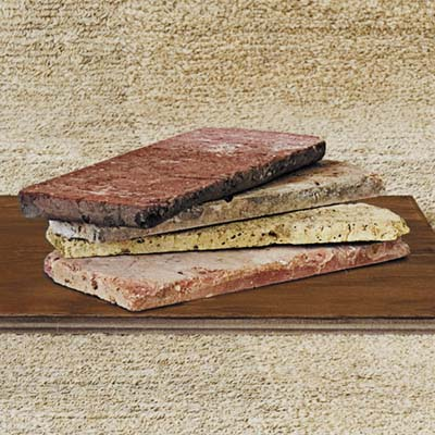 Vintage Brick Salvage slices reclaimed Chicago common brick into thin veneer for walls and flooring