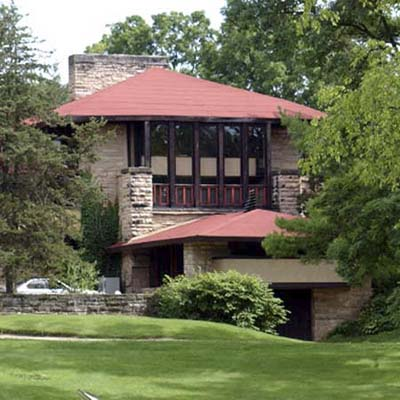 Red Taliesin House surrounded by greenery