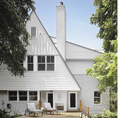 Steeply pitched gables and shed overhangs, standing-seam metal roof, rot-resistant cement-board clapboard and board-and-batten siding, energy-efficient windows, and a simple deck helped garner the house a 5-star green rating.