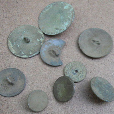 Clothes buttons found at the Titlow family home in Bedford, Massachusetts