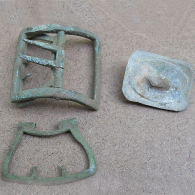 Harness or saddle buckles found at the Titlow family home in Bedford, Massachusetts