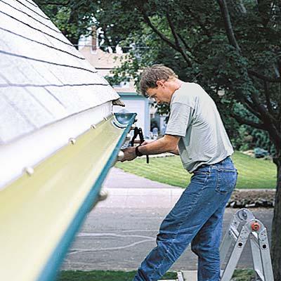person installing a gutter