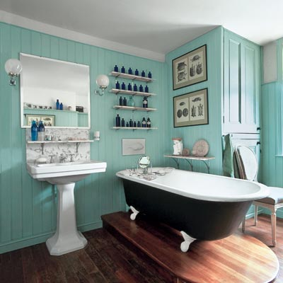 a turn-of-the-century vintage-style bath with a soaking tub and blue walls