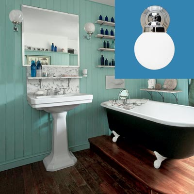 a turn-of-the-century vintage-style bath with wall-mounted sconce inset