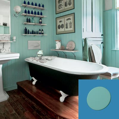 a turn-of-the-century vintage-style bath with turquoise paint blob inset