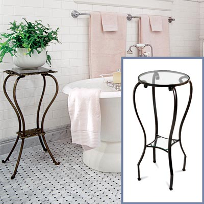 an iron-frame glass-top side table to go in a Victorian-style bathroom