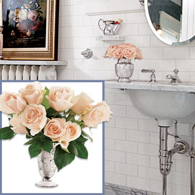 a silver vase with flowers to go in a Victorian-style bathroom