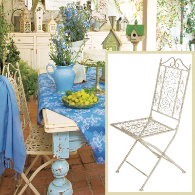Outdoor patio dining room with iron folding chairs