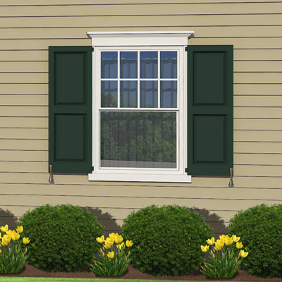 Lower window case topping along this colonial home 