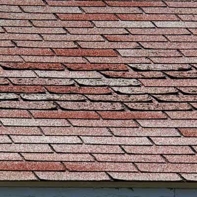 damaged asphalt roof shingles