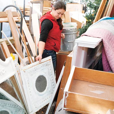woman looking through salvage materials