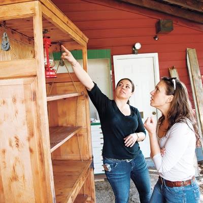 lantern inside reclaimed shelving unit
