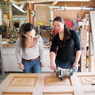 women working on salvaged furniture