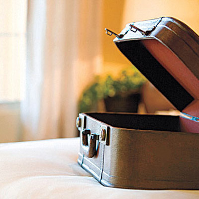 Open suitcase on the bed