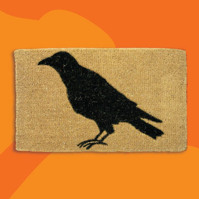 a coir welcome mat with a crow silhouette