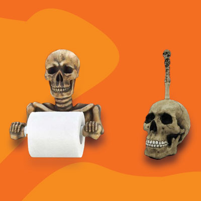 a skeleton toilet paper holder and a skull toilet brush holder
