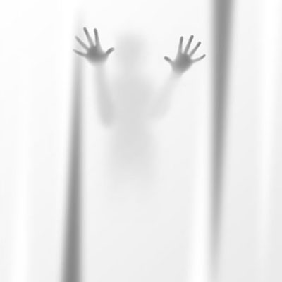 a shower curtain with a person's shadow on it for Halloween decoration