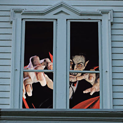 window with a menacing vampire looking out